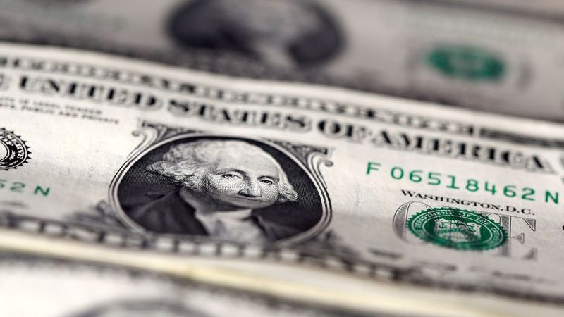 Dollar retreats again in Asia as solid data offsets virus worries