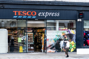 Tesco profits fall as Covid costs offset sales surge